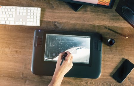 Graphic Designer working with Drawing tablet