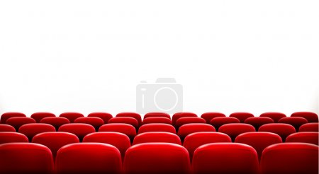 Rows of red cinema or theater seats in front of wh...