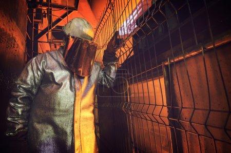 worker inside of steel plant