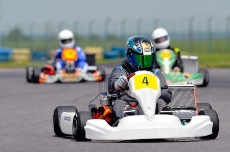 Photo for BUCHAREST, ROMANIA - MAY 17: Unknown pilots competing in National Karting Championship 2015 at Amkart Bucharest, on May 17, 2015 in Bucharest, Romania - Royalty Free Image
