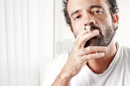 Photo for Middle Age man smoking indoor . - Royalty Free Image