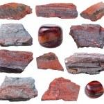 Set of jaspillite (jaspilite, ferruginous quartzite, taconite, itabirite) gemstones, minetal stones isolated on white background
