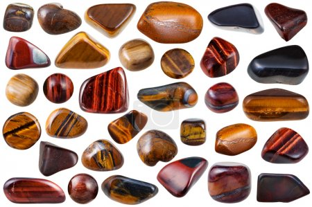 Photo pour Ensemble de diverses pierres minérales naturelles et pierres précieuses oeil de tigre (oeil de tigre, oeil de taureau, oeil de faucon) isolé sur fond blanc - image libre de droit