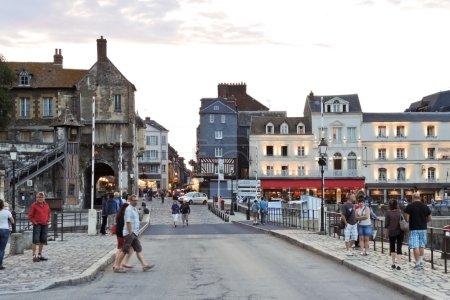 people on street in port of Honfleur town, France