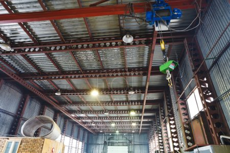 hoist with overhead crane and scales in warehouse
