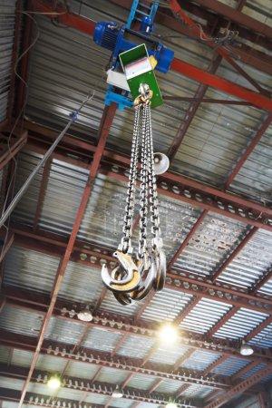 hooks of weigher bridge crane in warehouse