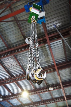 hooks of weigher overhead crane in warehouse