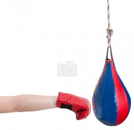 kid with boxing glove punches punching bag