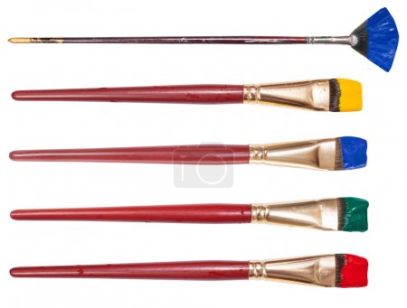 set of flat artistic paintbrushes with painted tips