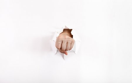 front view of the fist punches a paper