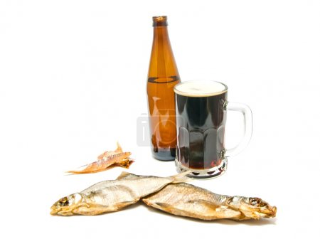 salted fishes and dark beer closeup
