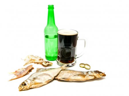 salty fishes and mug of dark beer on white