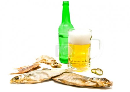 salty fishes and mug of light beer on white