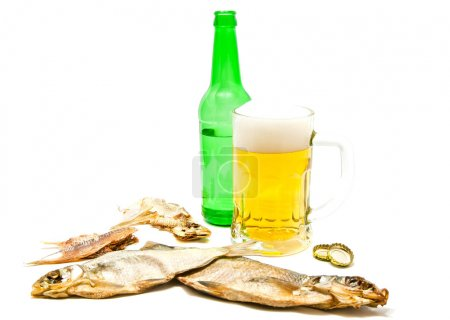 salty fishes and mug of beer on white