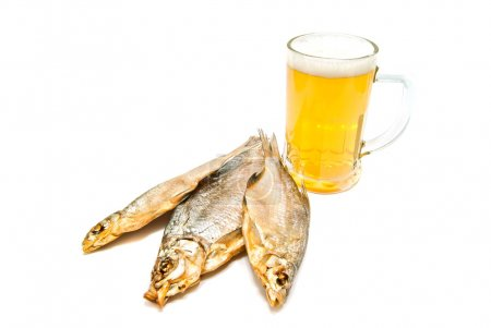 glass of beer and three salted fishes