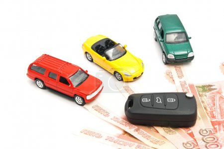 Different cars, keys and Russian banknotes