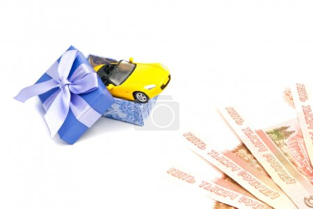 yellow car in blue gift box and banknotes