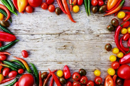Frame of various vegetables over a rustic wooden background