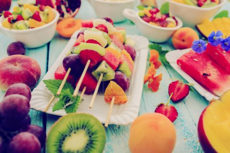 Photo for Fruit skewer, fruit salad - summer party - Royalty Free Image