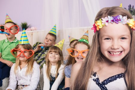 Photo for Happy smiling children celebrating birthday party at home - Royalty Free Image