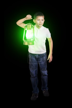 Boy in the darkness with green lantern