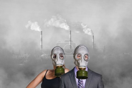 People wearing gas mask on factory background