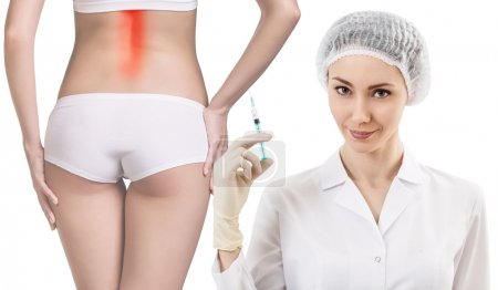 Photo for Woman with painful back stands nead doctor with syringe isolated on white background - Royalty Free Image