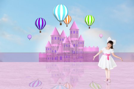 Little girl in front of a pink fairy castle