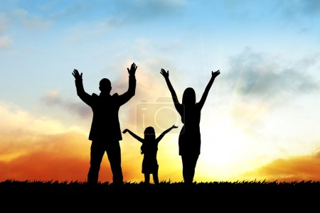 Silhouettes of happy family