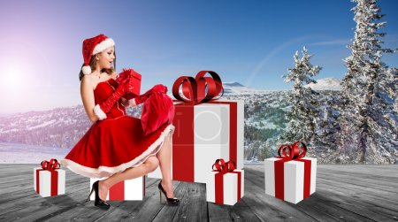 Photo for Beautiful and sexy woman wearing santa clause costume - Royalty Free Image