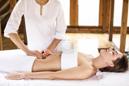 Woman having abdomen massage.