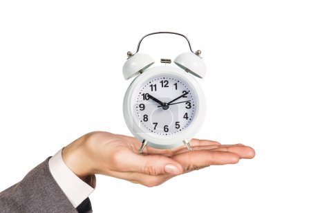 Alarm clock stands on the human palm