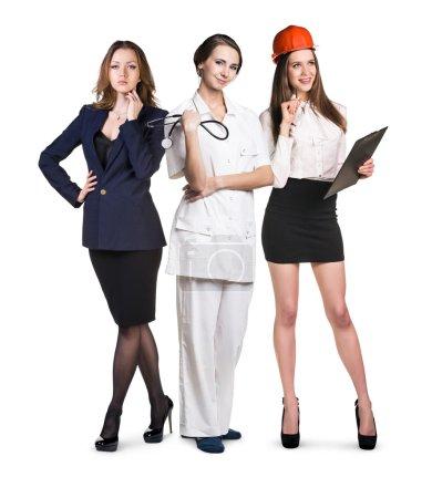 Photo pour Trois femmes souriantes attrayantes avec différentes professions isolées sur blanc - image libre de droit