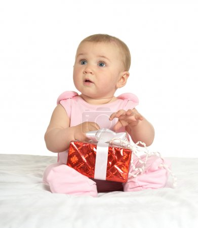 baby girl sitting  with gift
