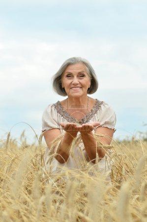 senior woman in summer field