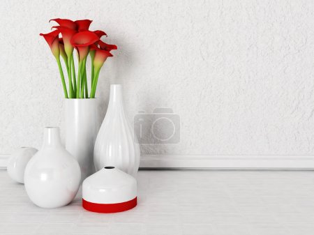 vases and flowers on the floor