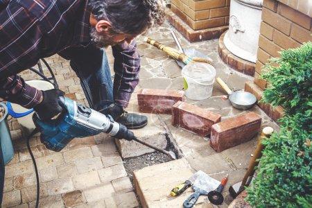 Man working in yard puncher