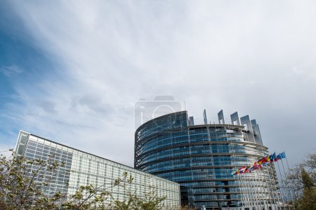 Photo for European Parliament building with all European union flags waving in wind on a spring day in Strasbourg, France Alsace - Royalty Free Image