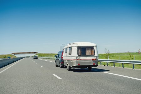 RV van and trailer driving fast to vacance destination