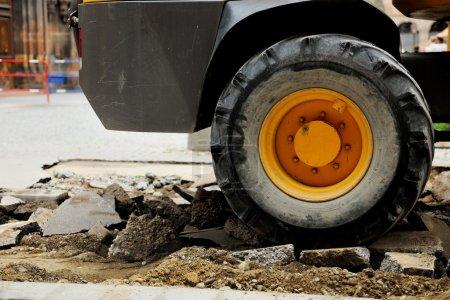 Truck tire on a broken asphalt