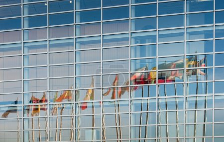 Photo for All European Union member countries flags reflected in European Parliament facade in Strasbourg, France, Alsace - Royalty Free Image