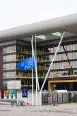 European Union Flag flies at half-mas Agora building