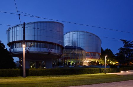 European Court of Human Rights building at dusk