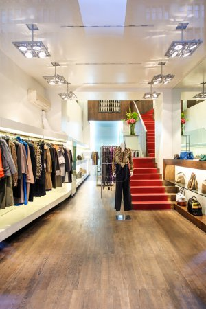 Interior of a boutique store with fashionable luxury women dress