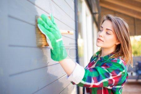 Woman applying protective varnish