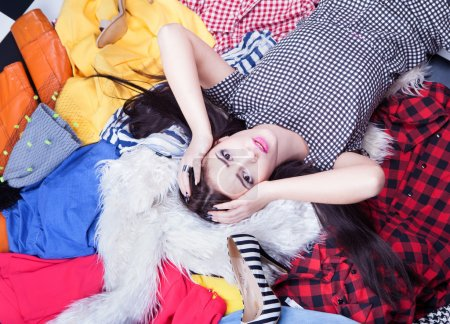 Woman lying down on a pile of clothes