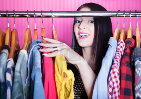 Surprised woman searching for clothing