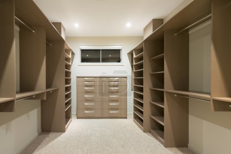 Photo for Big empty walk in wardrobe in luxurious house - Royalty Free Image