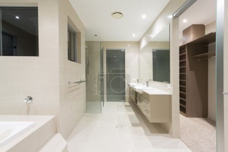 Photo for Spacious contemporary bathroom with spa and walk in robe - Royalty Free Image