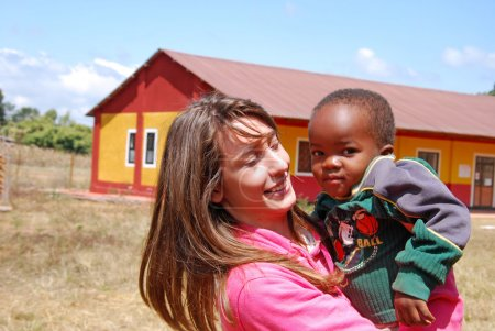 Photo pour August 2014-Village of Pomerini-Tanzania-Africa-A voluntary non-profit organization Smile to Africa plays with a small African child of the Village of Pomerini in Tanzania. - image libre de droit